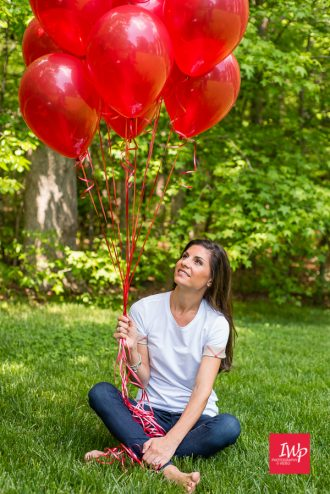 A picture of Jennifer with red ballons